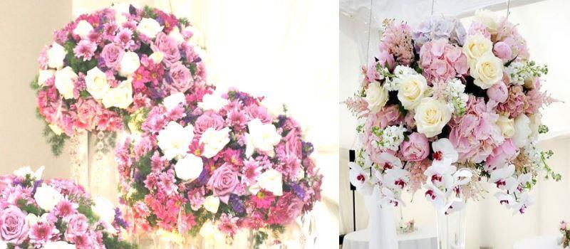 декоративные цветы в высоких вазах на свадьбу